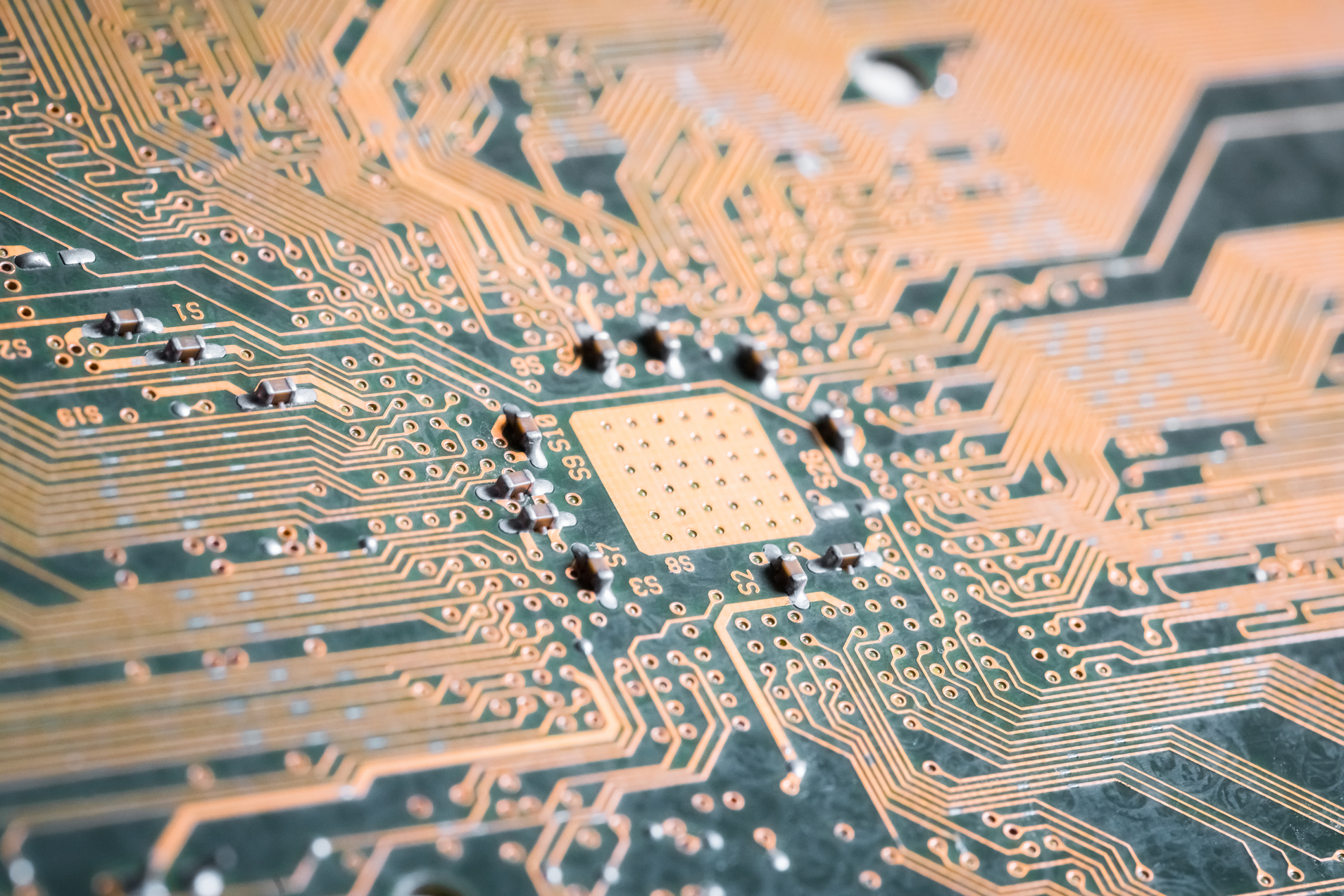 golden electronic circuit board as abstract technology background