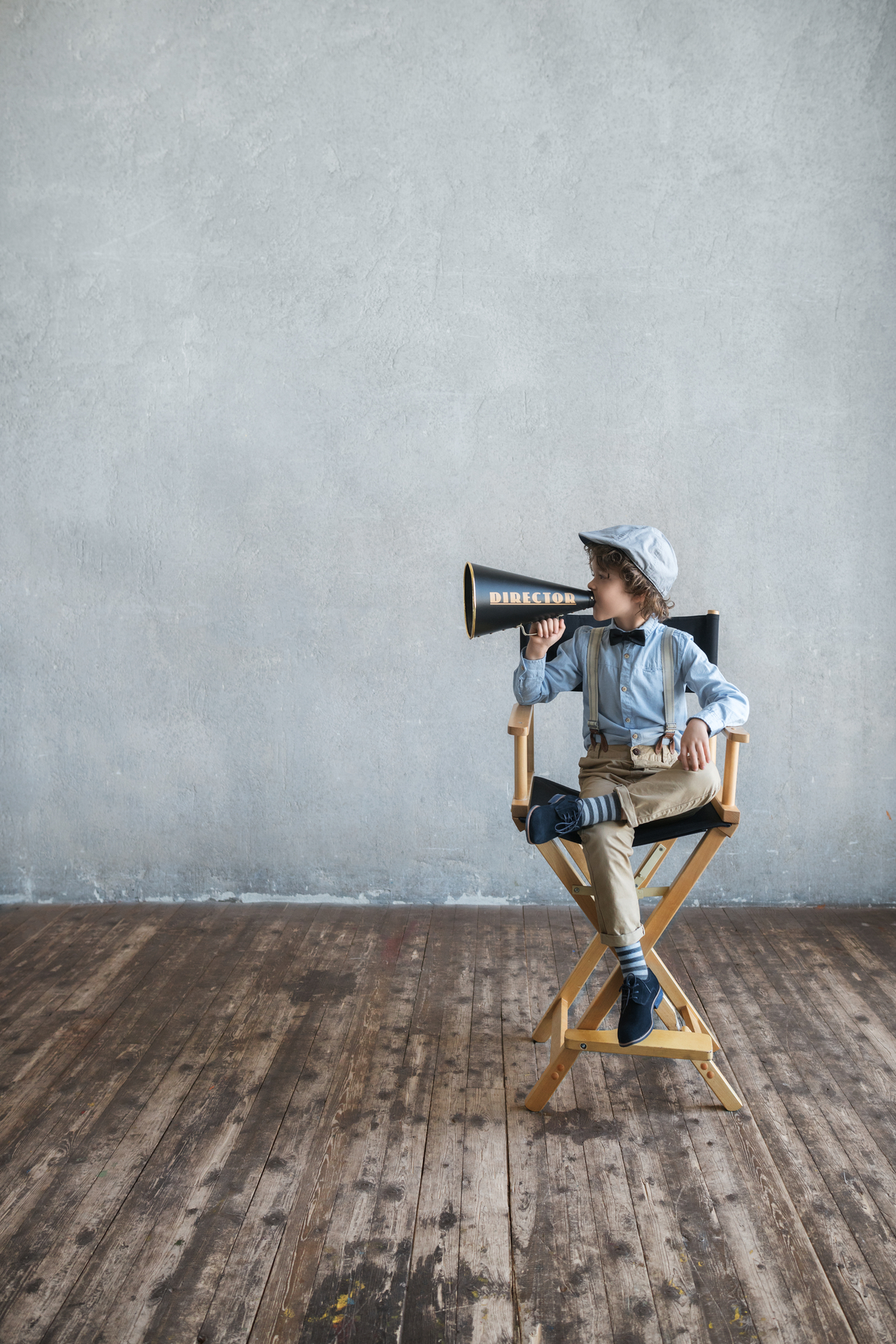 Little director with a megaphone in studio