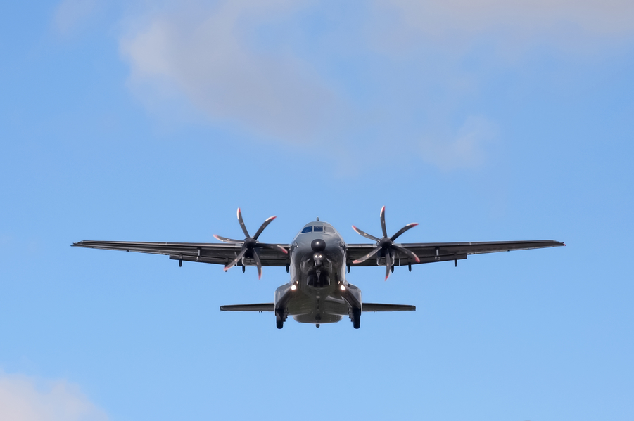 small propeller cargo aircraft on landing approach