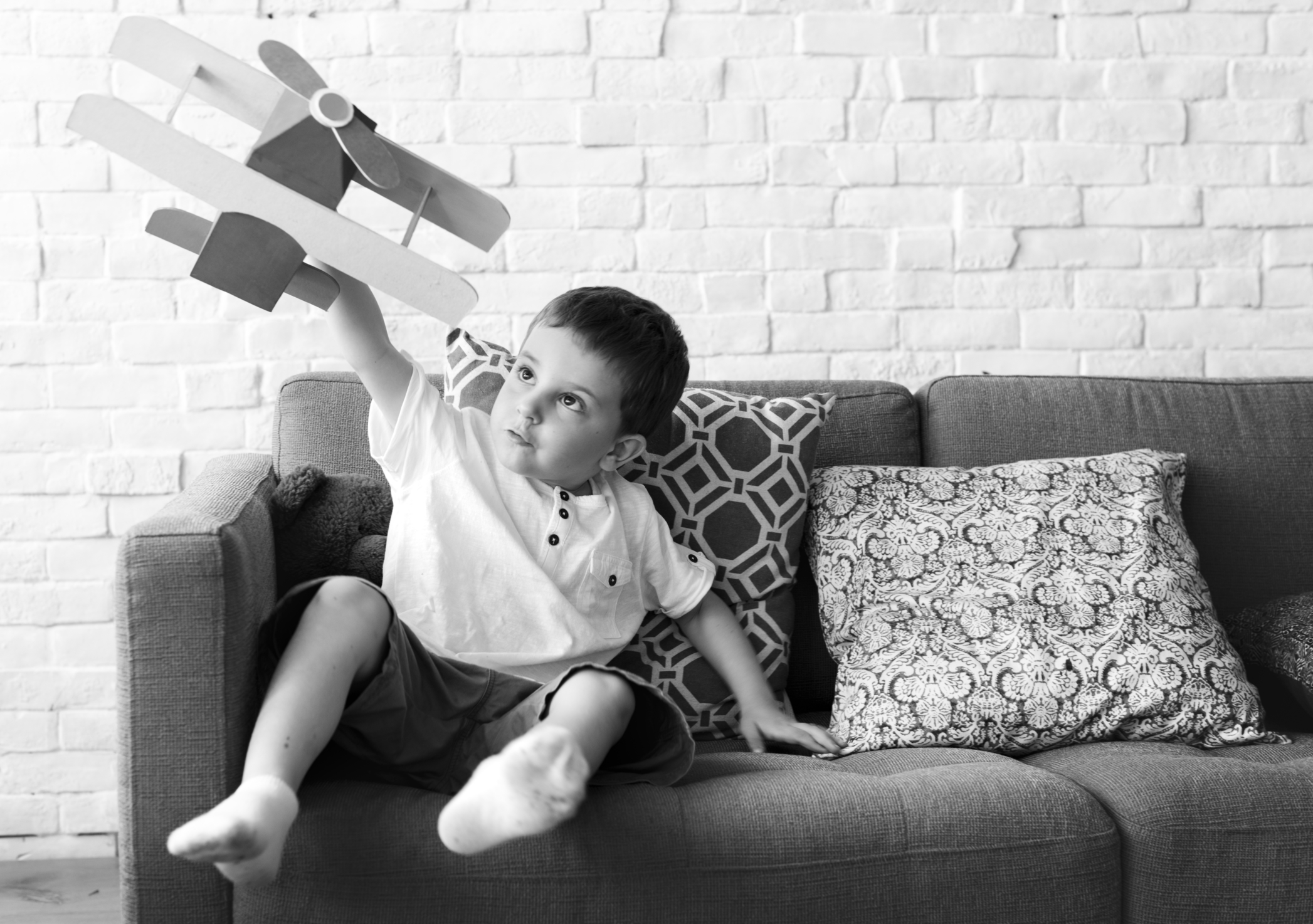 Boy Playing Plane Toy Aspiration