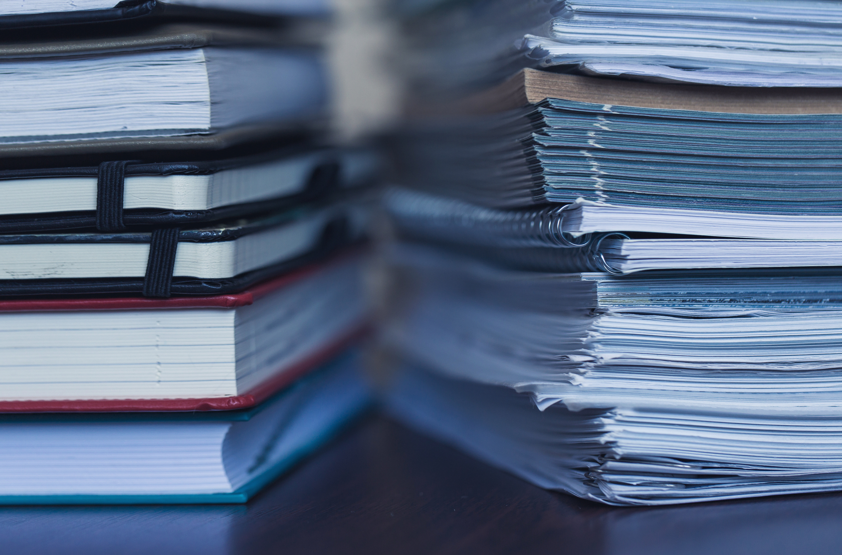 Accounting and taxes. Large pile of magazine and books closeup