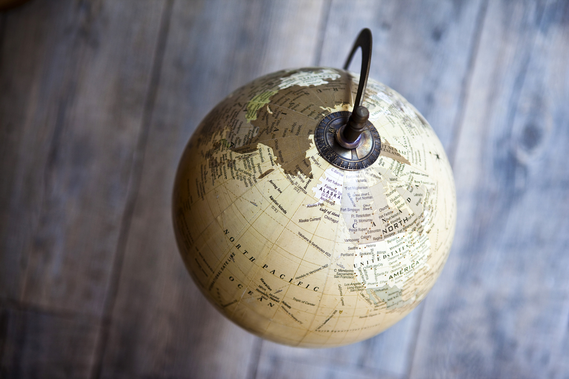 Old terrestrial globe on a wooden floor